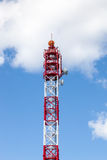 Antenna transmission tower., painted white and red in a day of c. Lear blue sky stock photography