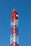 Antenna transmission tower., painted white and red in a day of c. Lear blue sky stock photos