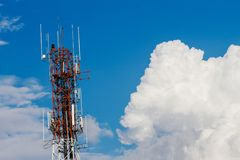 Antenna with white clouds in a bright day. Stock Photos