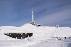 Antenna in winter at Puy de Dome. Antenna covered with snow in winter at the summit of Puy de Dome with blue sky Royalty Free Stock Image