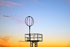 Antennae with sky under sunset Stock Images