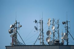 Antennas. Many antennas on the roof of a tall building Stock Image