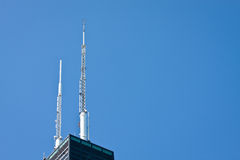 Antennas. Two antennas at a top of a building, symbol of modern communications Stock Photography
