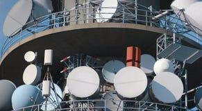 Antennas. Communication tower with tv and radio antenna royalty free stock photos