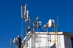 Antennas. Many antennas on the roof of a tall building Royalty Free Stock Photos
