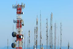Antennas. Big red and white antenna with blue sky Stock Photos