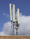 Antennas. Cellular service provider antennas on a roof top Stock Photos
