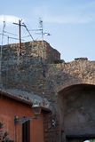 Antennas on ancient wall. Antennas erected on ancient wall In Ostia near Rome, italy Royalty Free Stock Image