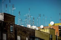 Antennas. Ceiling with lots of antennas and dishes stock image
