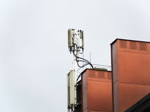 Antennas on a chimney. Cellphone antennas on a red chimney Stock Photos