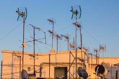Antennas in the evening sun on a roof in Seville stock photos