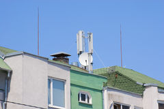 Antennas on a house. Cellular telephony and television antennas on a house royalty free stock photography