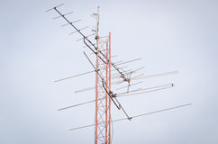 Antennas. Multiple antennas mounted on the roof Royalty Free Stock Photography