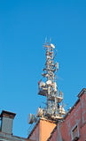 Antennas on old roofs Royalty Free Stock Image
