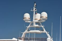 Antennas and radar of a luxury yacht. For communication between port authorities and other ships royalty free stock photo