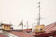 Antennas on the roof. Many antennas on the roof of the house Royalty Free Stock Image