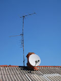 Antennas on the roof of an old house Royalty Free Stock Image