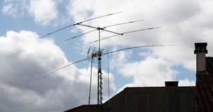 Antennas on roof timelapse 4K video. Communication concept stock footage