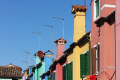 Antennas on roofs of colorful houses in Burano, Venice, Italy Royalty Free Stock Photo