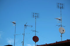 Antennas. On the roofs outside houses and buildings Royalty Free Stock Photo