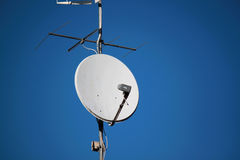 Antennas. On the roofs outside houses and buildings Royalty Free Stock Photos