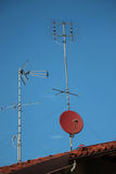 Antennas. On the roofs outside houses and buildings Royalty Free Stock Photography