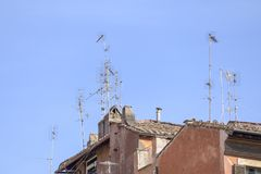Antennas on the roofs of Rome.  royalty free stock photo