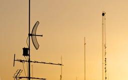 Antennas. Silhouette of antennas at sundown Royalty Free Stock Photo