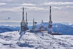Antennas station at peak of mountain royalty free stock photography
