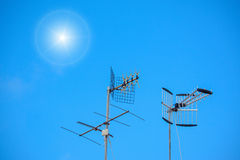Antennas and sun Stock Photo