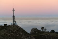 Antennas. Telecommunication antennas with a sea of clouds in the background stock image