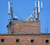 Antennas on the top of an old warehouse building Royalty Free Stock Photo
