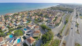 Aerial shot of luxury cottages along coastline. Top view of beautiful seascape Stock Footage