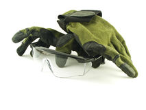 Anteojos y guantes de seguridad en el fondo blanco Foto de archivo libre de regalías