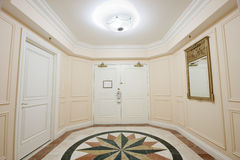 Anteroom with double door and mosaic marble floor. Anteroom with white double door and mosaic marble floor royalty free stock photography