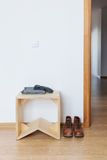 Anteroom with wooden stool and leather Stock Image