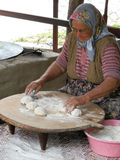 ANTHALYA, TURKEY, JULY 7,2017 Old woman making turkish bread with daughter royalty free stock photos