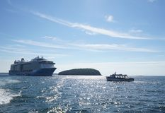 Anthem of the Seas, Royal Caribbean. Cruise ship in Bar Harbor Maine - Frenchman Bay near Porcupine islands with smaller boat approaching Stock Photography
