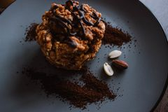 Anthill cake with chocolate and coffee on a dark background. Dessert with nuts and raisins. Bolo formigueiro. Russian funnel cake. Recipe royalty free stock images