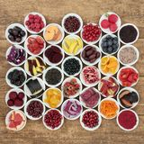 Anthocyanin Health Food Variety. Anthocyanin health food selection in porcelain bowls on rustic wood background. Also high in antioxidants, vitamins and minerals stock images