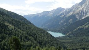Antholzer Valley. The alpine landscape of Antholzer valley, South Tyrol, Italy, as seen from the Staller Sattel, Eastern Tyrol, Austria stock video footage