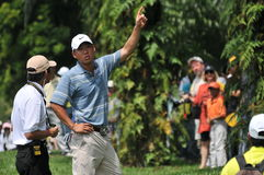 Anthony Kim consulting the referee. 2009 Maybank Malaysian Open Day 3, Anthony Kim shoots one under of 71 for the day Royalty Free Stock Images