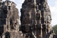 Anthropomorphic faces carved into stone at the Bayon Wat in late afternoon light, a 12th century temple with royalty free stock images