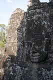 Anthropomorphic faces carved into stone at the Bayon Wat, a 12th century temple within the Angkor Thom complex royalty free stock images