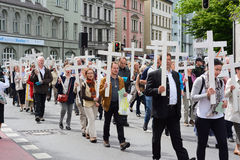 Anti-Abortion Demonstration. MUNICH, GERMANY - MAY 10, 2014:  Anti-Abortion Demonstration with participants carrying Christian Crosses and banners.  Hundreds Stock Photos