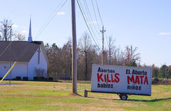 Anti-abortion Sign. An anti abortion sign in front of a church stock photos