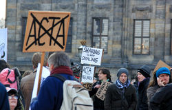Anti-ACTA protest in Amsterdam, the Netherlands. Protesters carrying anti-ACTA placards rally in Europe to express their anger over the treaty and urge the Royalty Free Stock Photo