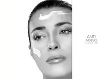 Anti Aging and Beauty Concept. Spa Treatment. Template Design. Anti Aging and beauty concept with a monochrome portrait of a gorgeous woman with cosmetic cream Stock Image