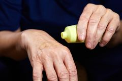 Anti aging cream for hands Stock Photos