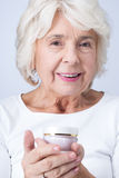 Anti-aging cream helps to keep your face young Royalty Free Stock Photos